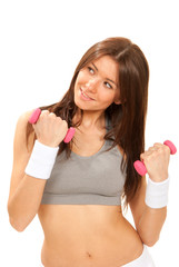 fitness female instructor workout dumbbells in gym