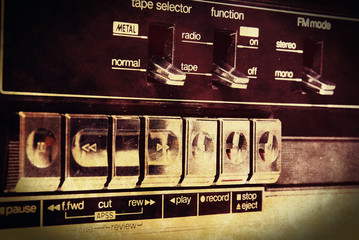 Grunge cassette deck control panel, close up