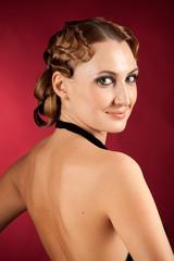 Nude back of elegant smiling female