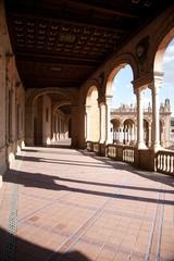 arcade at public Spain Square in Seville