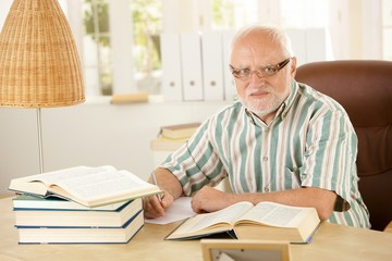 Older man working at his study