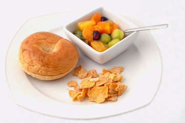 healthy kids lunch with fresh fruits bagel and cereals