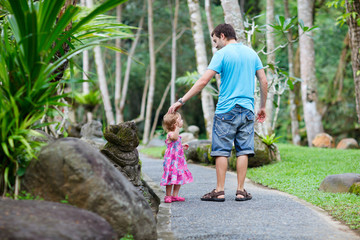Father and little daughter at tropical park