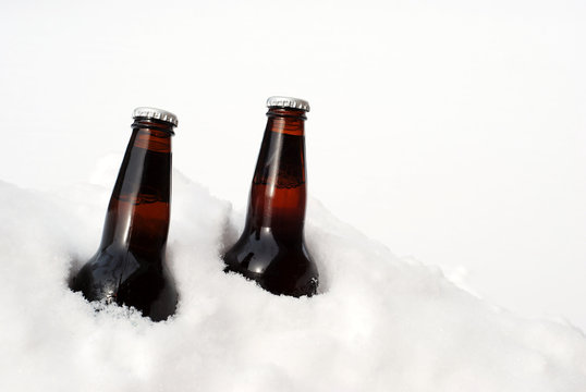 two beers in the snow