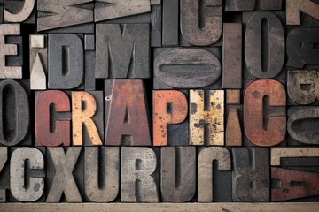 The word 'Graphic' spelled out in very old letterpress blocks.