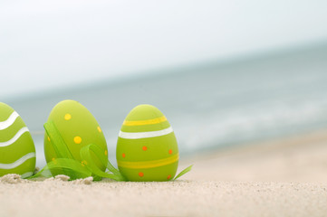 Easter decorated eggs on sand