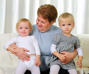 two twins sisters with their grandmother
