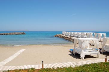 Huts at the beach of luxury hotel, Crete, Greece