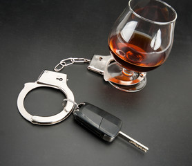 Car key locked to glass of alcohol