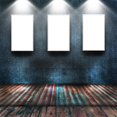 Empty frames in grunge room with spotlight
