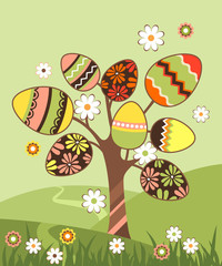 Spring landscape with easter blossoming tree and eggs