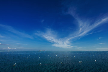 A beautiful blue sky with clouds and blue ocean