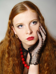 ortrait of the girl with long red-hair