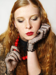 portrait of then beautiful girl with red beads