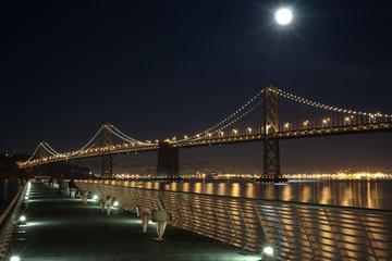 Bay Bridge at Night from pier in San Francisco