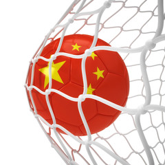Chinese soccer ball inside the net