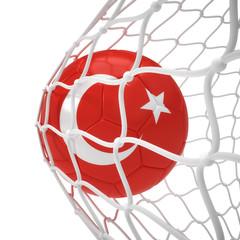 Turkish soccer ball inside the net