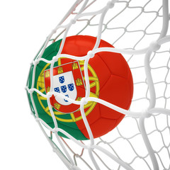 Portuguese soccer ball inside the net