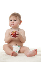Sweet small baby with apple.