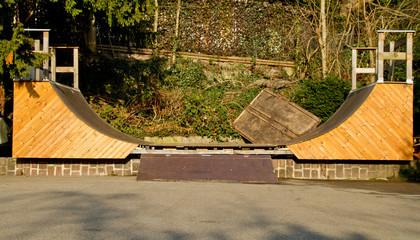 handmade wooden halfpipe in skatepark
