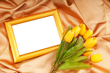 Picture frames and tulips flowers on satin