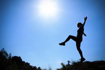 Young woman walking in the sun