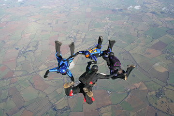 Four skydivers training