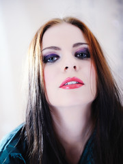 Beautiful woman face with fashion make-up in violet tones