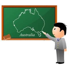 small boy, drawing on the blackboard a map of Australia