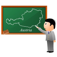 small boy, drawing on the blackboard a map of Austria
