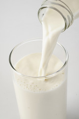 close up of milk on white background