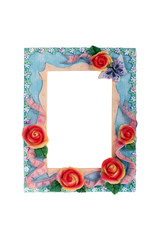 Photo frame with roses isolated on white