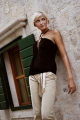 Beautiful blond girl posing outdoors