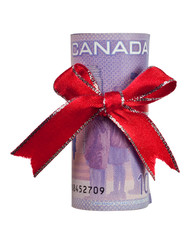 Ten Canadian dollars wrapped by ribbon isolated on white