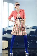 High fashion model in red dress posing