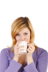 Young woman with a coffee mug (white background)