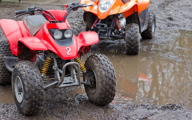 Two quad bikes ready for action in the mud