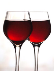Red wine glasses on white background