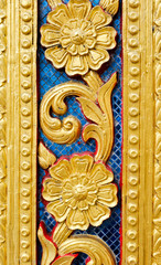 Golden flower of  carvings on wood