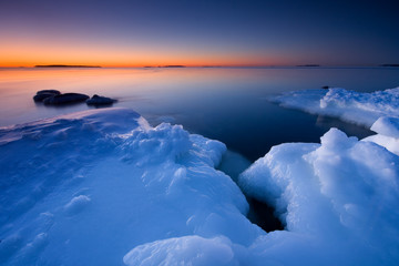 Sunrise and icy beach