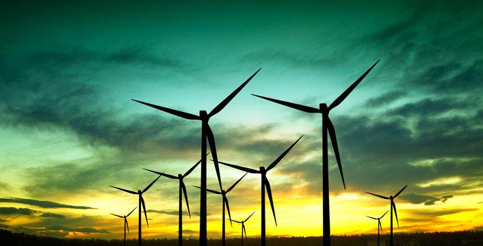 Wind turbines silhouette at sunset