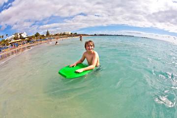boy has fun at the beach