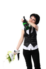 Bride drinking from a bottle of champagne