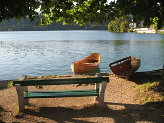 Relax on Bled's lake, bench in front of the boats