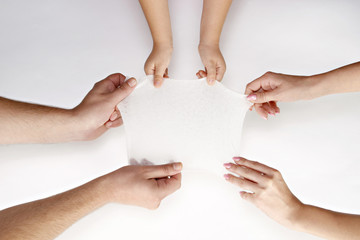 hands on white background holding a wipe