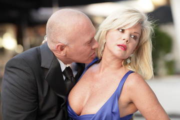Man trying to kiss the woman on the neck