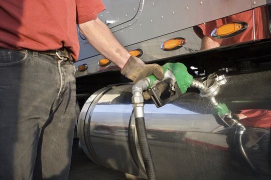 Man fueling Up a Freight Transport Truck