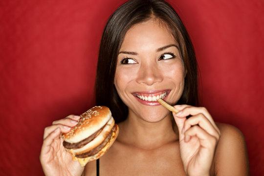 Junk food woman eating burger