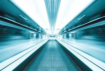 symmetric moving blue escalator inside contemporary airport