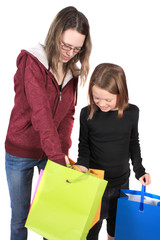 Two girls looking in bags